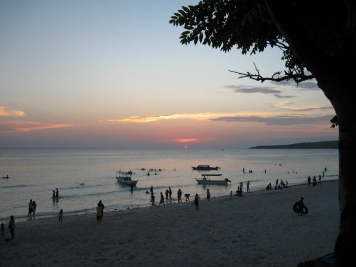 on the beach during sunset - Manado